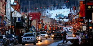 Escape Case team building, Park City Utah. Busy downtown Park City streets full of Christmas lights, people, and cars during the winter.