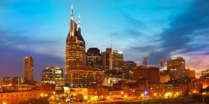 Escape Case team building Nashville Tennessee. Dim evening skies of purple, blues hues above the lively city center. A bustling metropolis rich with labor and play even in the coming of night.