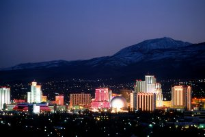 Reno, Nevada city skyline at night lit up by many lights. Escape Case team building Reno.